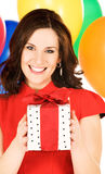 Woman with gift box and balloons Stock Photos