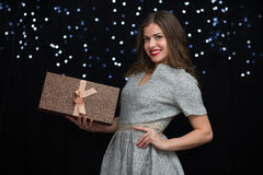 Woman with a gift box Stock Photo