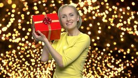 Woman with gift box on bokeh ights background. stock footage