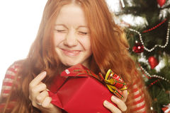 woman with gift box and christmas tree Royalty Free Stock Images