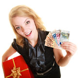 Woman with gift box and euro currency money banknotes. Royalty Free Stock Images