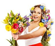 Woman with gift box and flower. Woman with gift box and flower bouquet . Isolated Royalty Free Stock Images