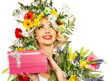 Woman with gift box and flower. Stock Image