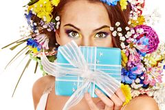Woman with gift box and flower bouquet . Royalty Free Stock Image