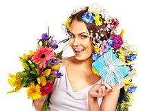 Woman with gift box and flower bouquet . Royalty Free Stock Photos