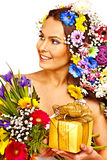 Woman with gift box and flower. Royalty Free Stock Photo