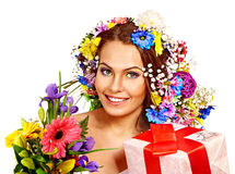 Woman with gift box and flower bouquet . Stock Images