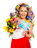 Woman with gift box and flower bouquet . Royalty Free Stock Photography