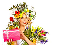 Woman with gift box and flower. Royalty Free Stock Photos