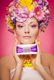 Woman with gift box and flowers hair Royalty Free Stock Photography