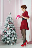 Woman with gift box near fir tree. Christmas, New Year eve Stock Photography