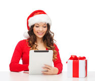 Woman with gift box and tablet pc computer Stock Photos