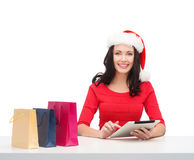 Woman with gift box and tablet pc computer Royalty Free Stock Image