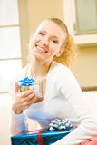 Woman with gift boxes at home Royalty Free Stock Photography