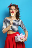 Woman with a gift and candy.  Pin up style. Stock Photography