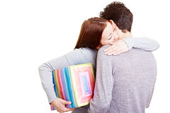 Woman with gift embracing man Royalty Free Stock Photo