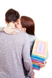 Woman with gift giving a hug Stock Photography
