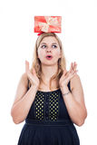 Woman with gift on the head Stock Photos
