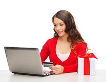 Woman with gift, laptop computer and credit card Stock Photos