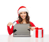 Woman with gift, laptop computer and credit card Stock Images
