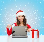 Woman with gift, laptop computer and credit card Royalty Free Stock Image