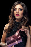 Woman with gift lookin sensual to the camera Royalty Free Stock Photo
