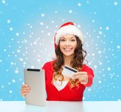 Woman with gift, tablet pc and credit card Stock Image