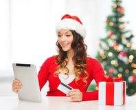 Woman with gift, tablet pc and credit card Stock Photography