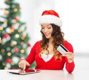 Woman with gift, tablet pc and credit card Royalty Free Stock Photography