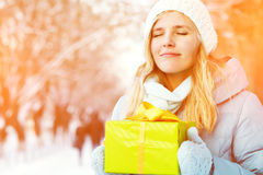 Woman with a gift in their hands Stock Photo