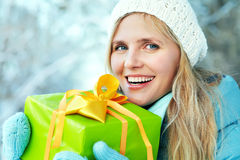 Woman with a gift in their hands Royalty Free Stock Image