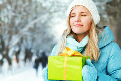 Woman with a gift in their hands Royalty Free Stock Photos