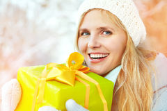 Woman with a gift in their hands Stock Photography