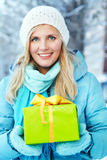 Woman with a gift in their hands Stock Photos