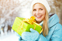 Woman with a gift in their hands Royalty Free Stock Photography