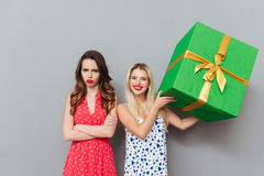 Woman with gift and woman without one Stock Image