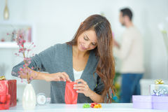 Woman gift wrapping present. Woman gift wrapping a present stock photography