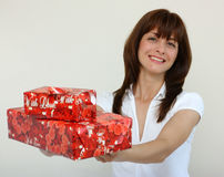A woman with gifts Royalty Free Stock Image