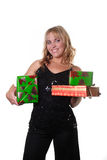 Woman with gifts. Woman holds gifts for christmas Royalty Free Stock Image