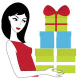 Woman with gifts. Young woman holding a pile of gifts Royalty Free Stock Image