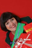 Woman and gifts. Smiling woman, holding gifts stock photos