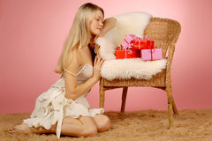 Woman & gifts Royalty Free Stock Images