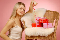 Woman & gifts. The girl with New Year's  gifts Royalty Free Stock Photo