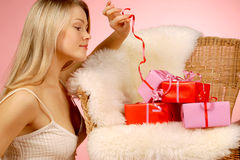 Woman & gifts Stock Photography