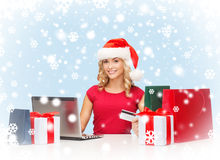Woman with gifts, laptop computer and credit card Royalty Free Stock Image