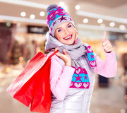 Woman with gifts after shopping to the new year at shop Stock Photos