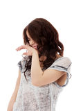 Woman giggles covering her mouth with hand Royalty Free Stock Image