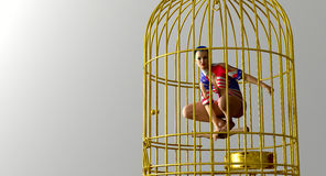 Woman in a gilded cage. Living a  wealth and luxury but to be without true freedom concept Royalty Free Stock Photos