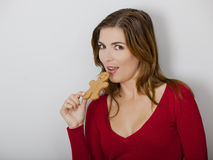Woman with a Gingerbread cookie Stock Image