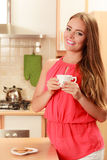 Woman with gingerbread cookies drinking tea coffee Stock Image